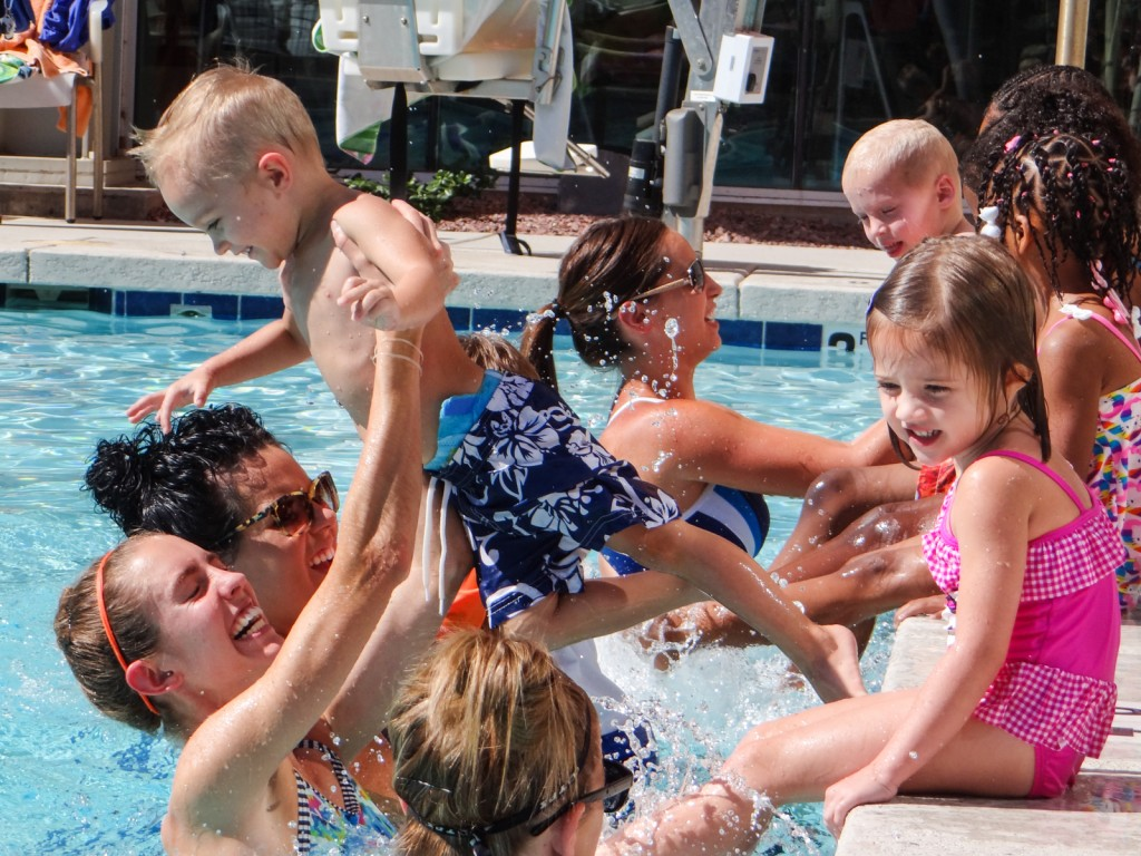 Adults in the pool with children